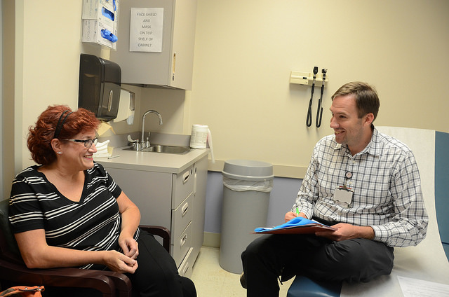 A pharmacist discusses medications with a patient.
